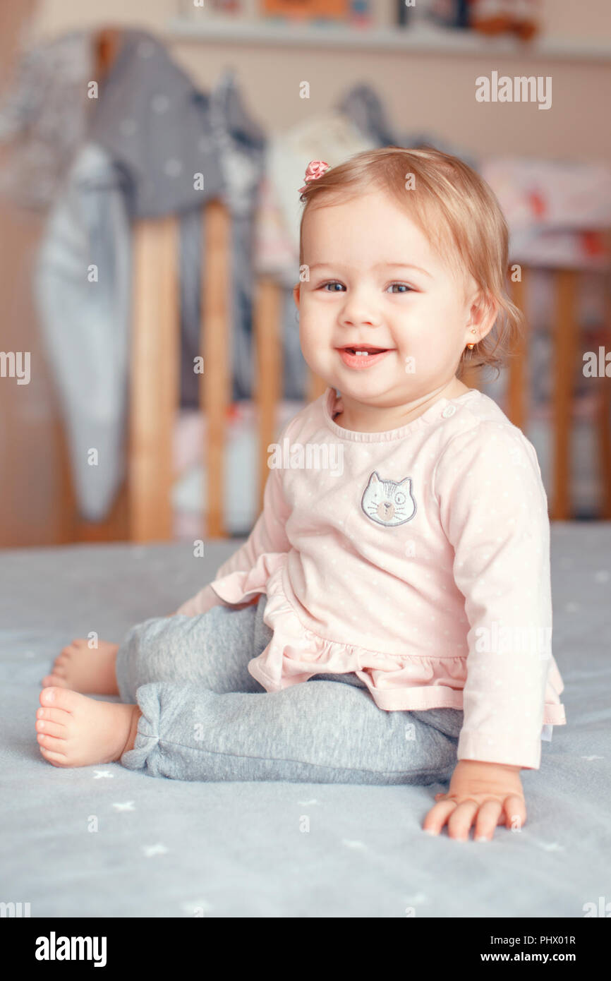 Portrait Of Cute Adorable Caucasian Blonde Smiling Baby Girl With