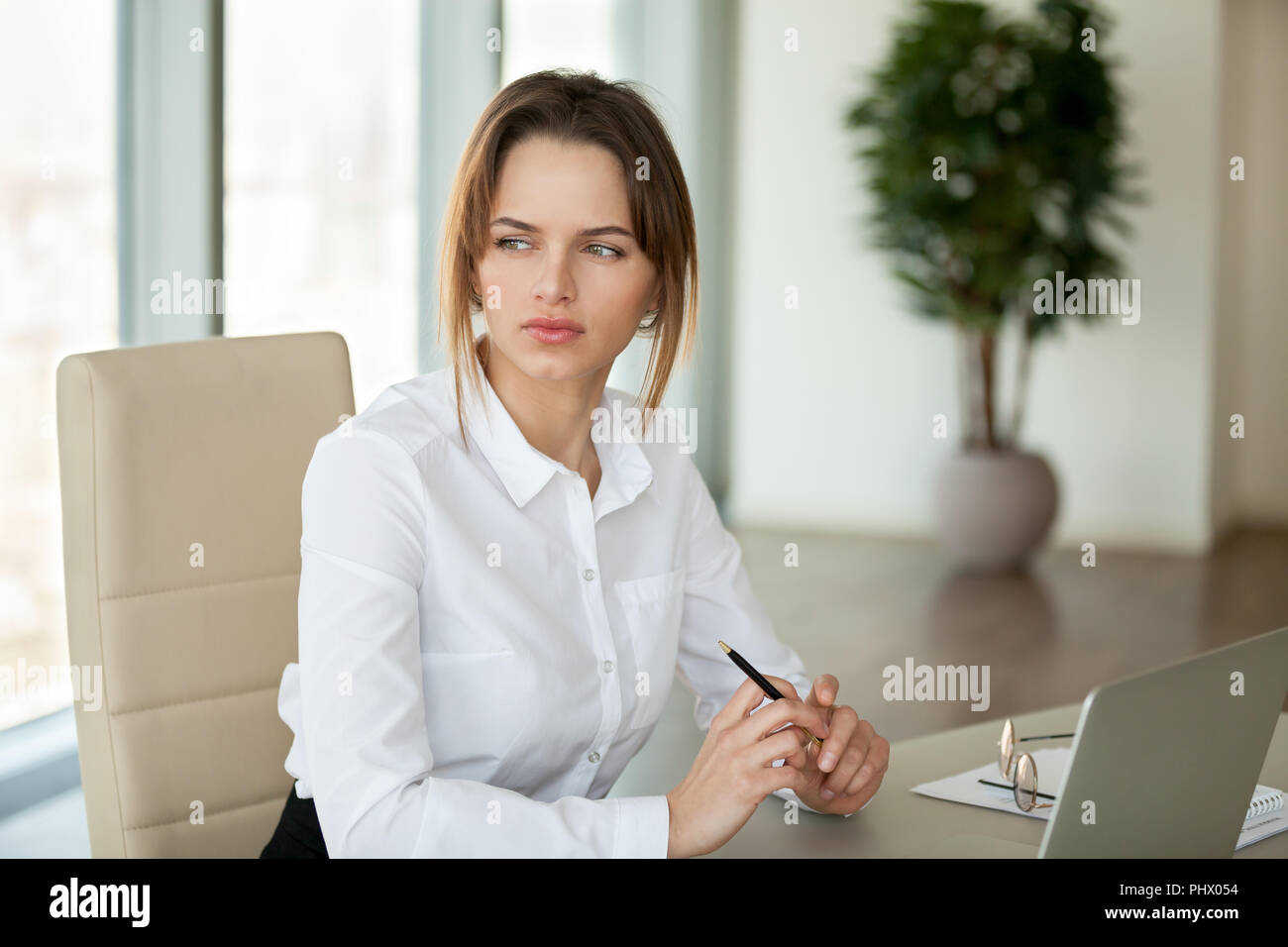 Thoughtful serious businesswoman thinking of problem feeling lac - Stock Image