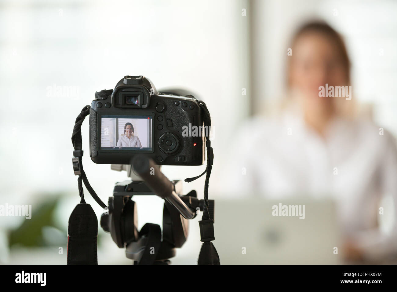 Professional dslr digital camera filming vlog of business woman  - Stock Image