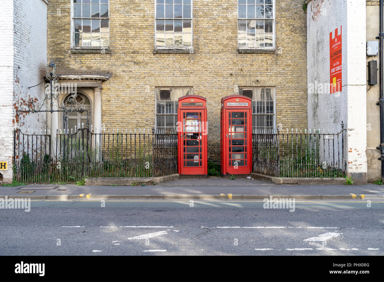 Decaying red telephone kiosks - Stock Image