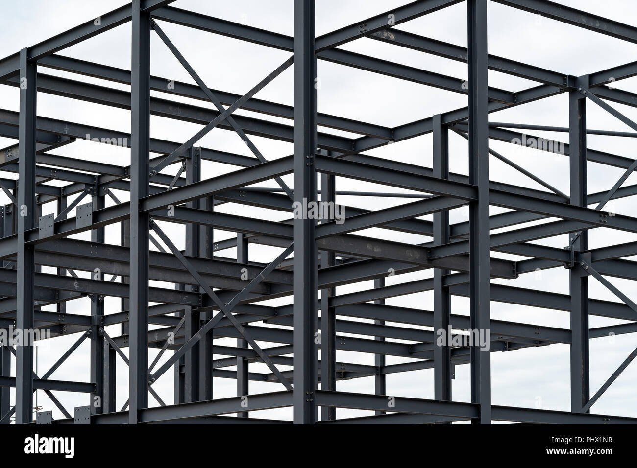Abstract picture of steelwork against white sky - Stock Image