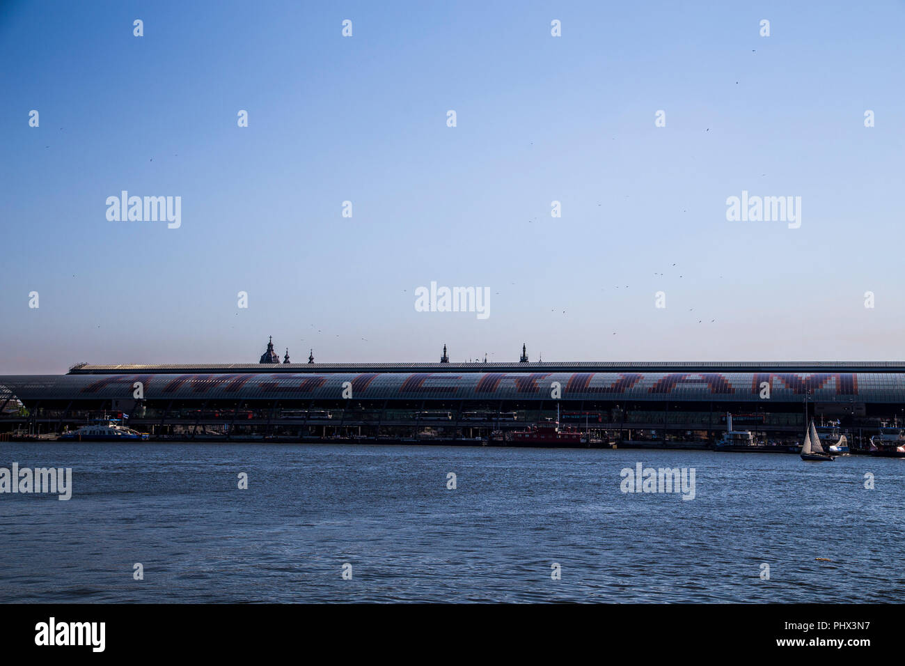 'Amsterdam Centraal' train station in Amsterdam, Netherlands - Stock Image