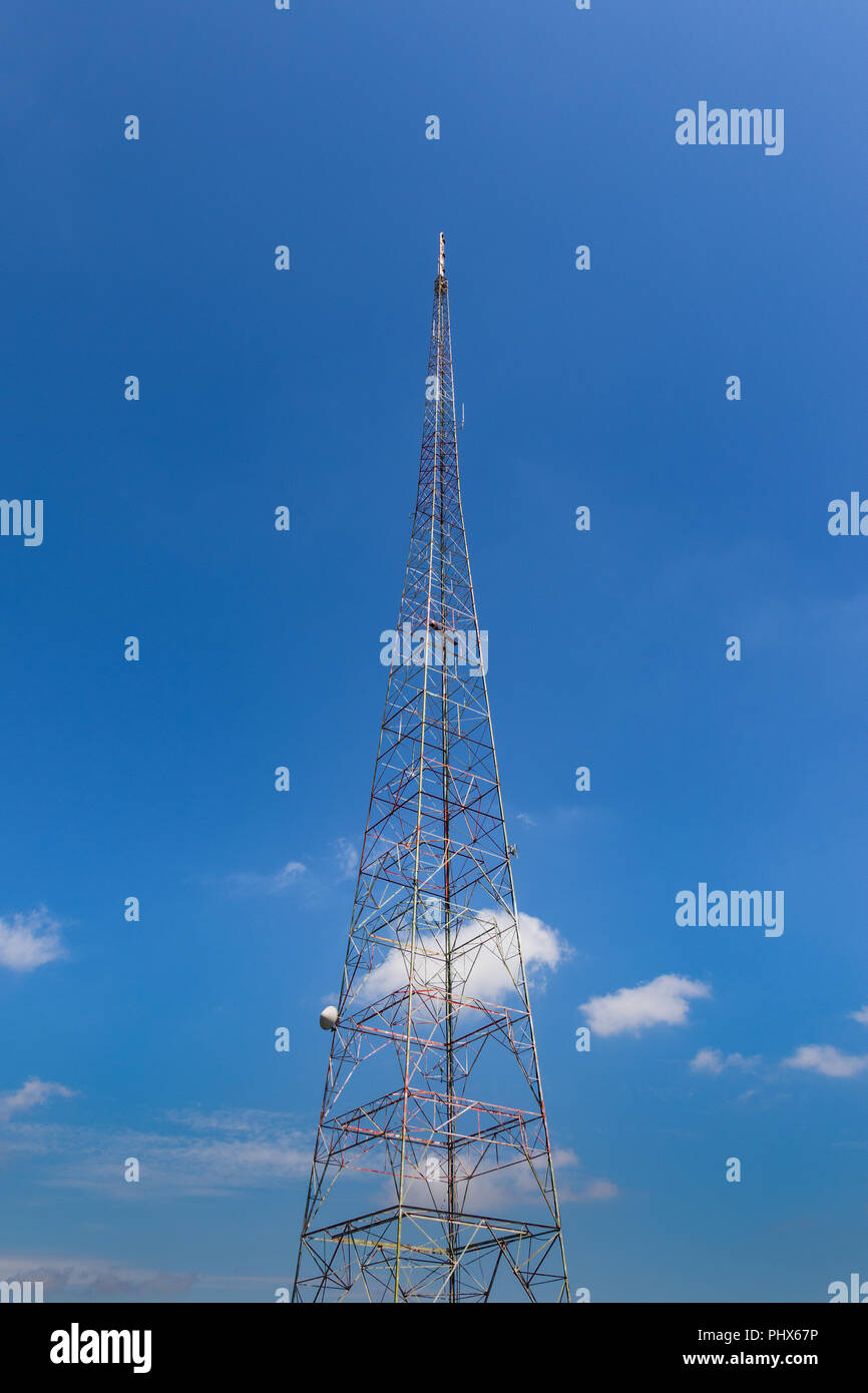 An old TV broadcast tower, against a blue sky. Stock Photo