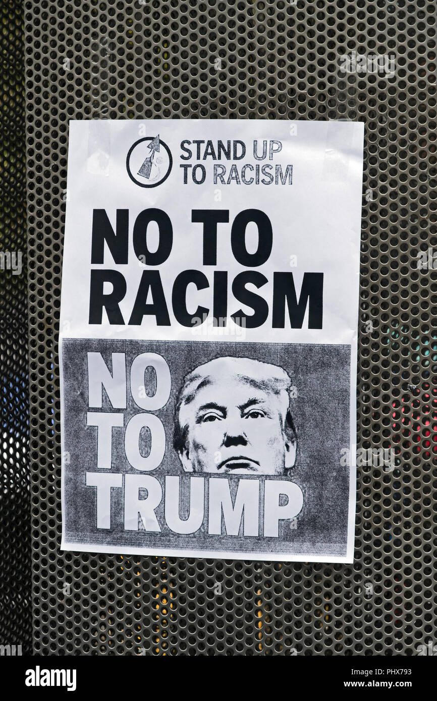 A poster featuring Donald Trump at a demonstration against his election as US president in Bristol, UK on 12 November 2016 - Stock Image