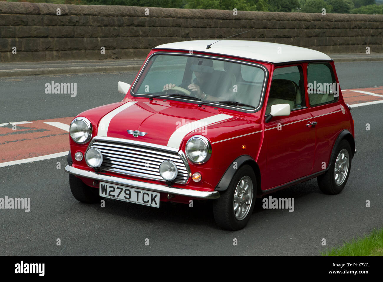 Multi coloured 2000 Rover Mini Cooper at Hoghton towers annual classic vintage car rally, UK - Stock Image