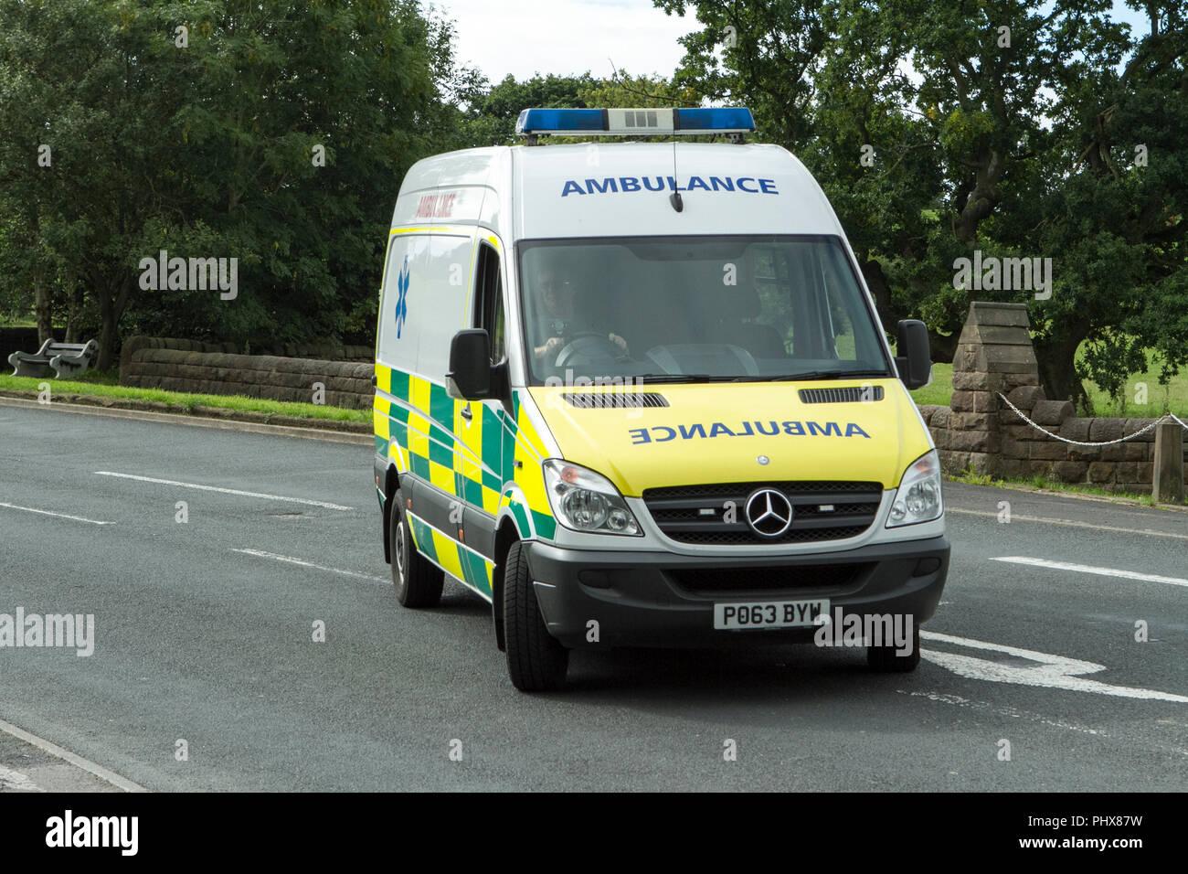 emergency ambulance paramedic urgent aid medic medical urgency assist first aid doctor rescue mercedes sprinter van - Stock Image