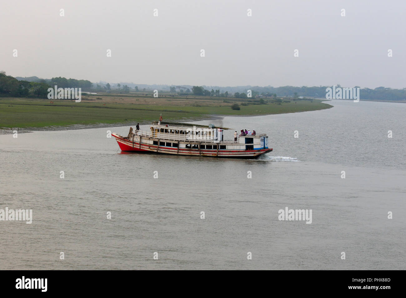 A small passenger vessel on Tetulia River, Patuakhali, Bangladesh. - Stock Image