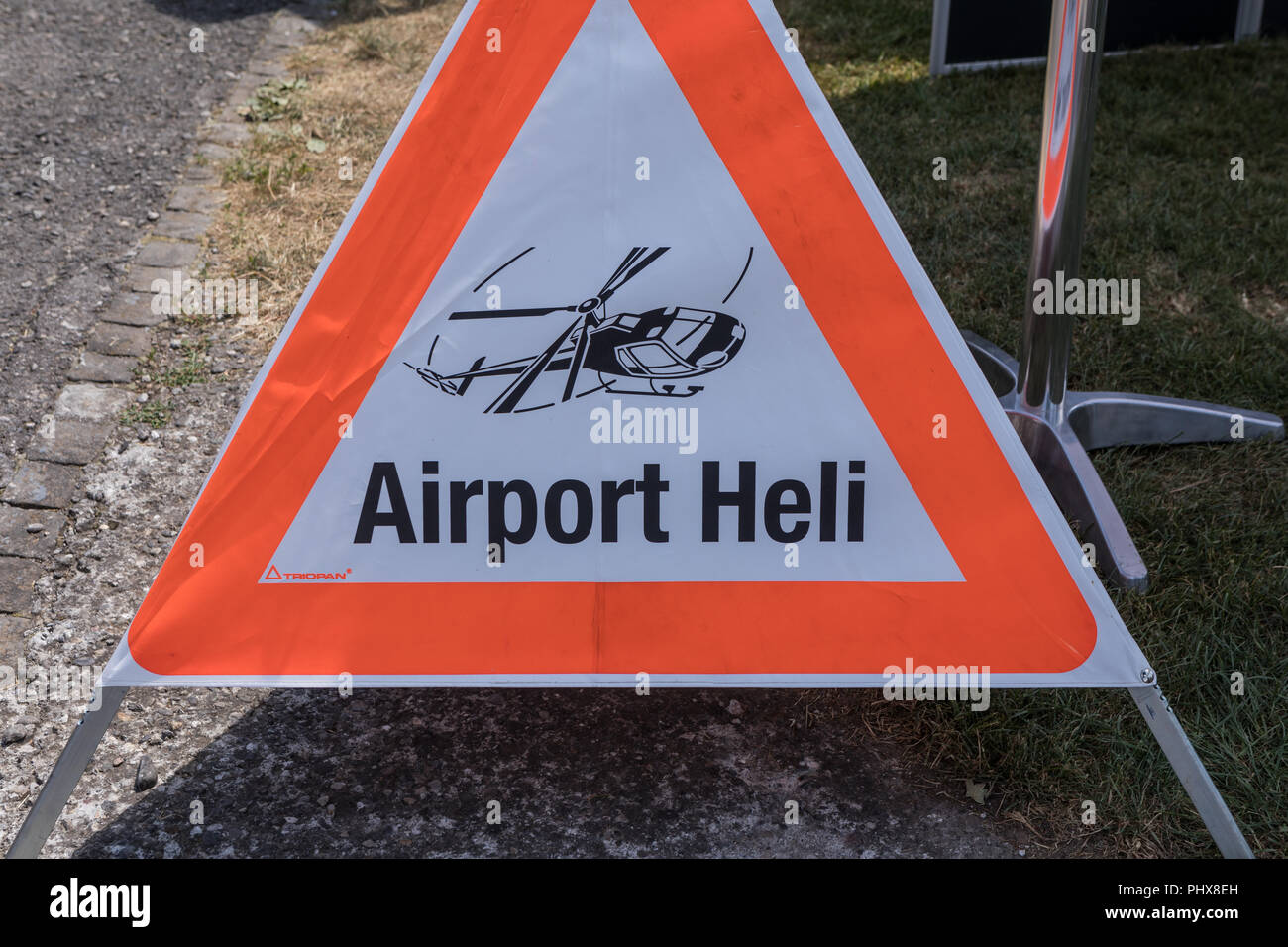 Warning triangle with airport heli - Stock Image