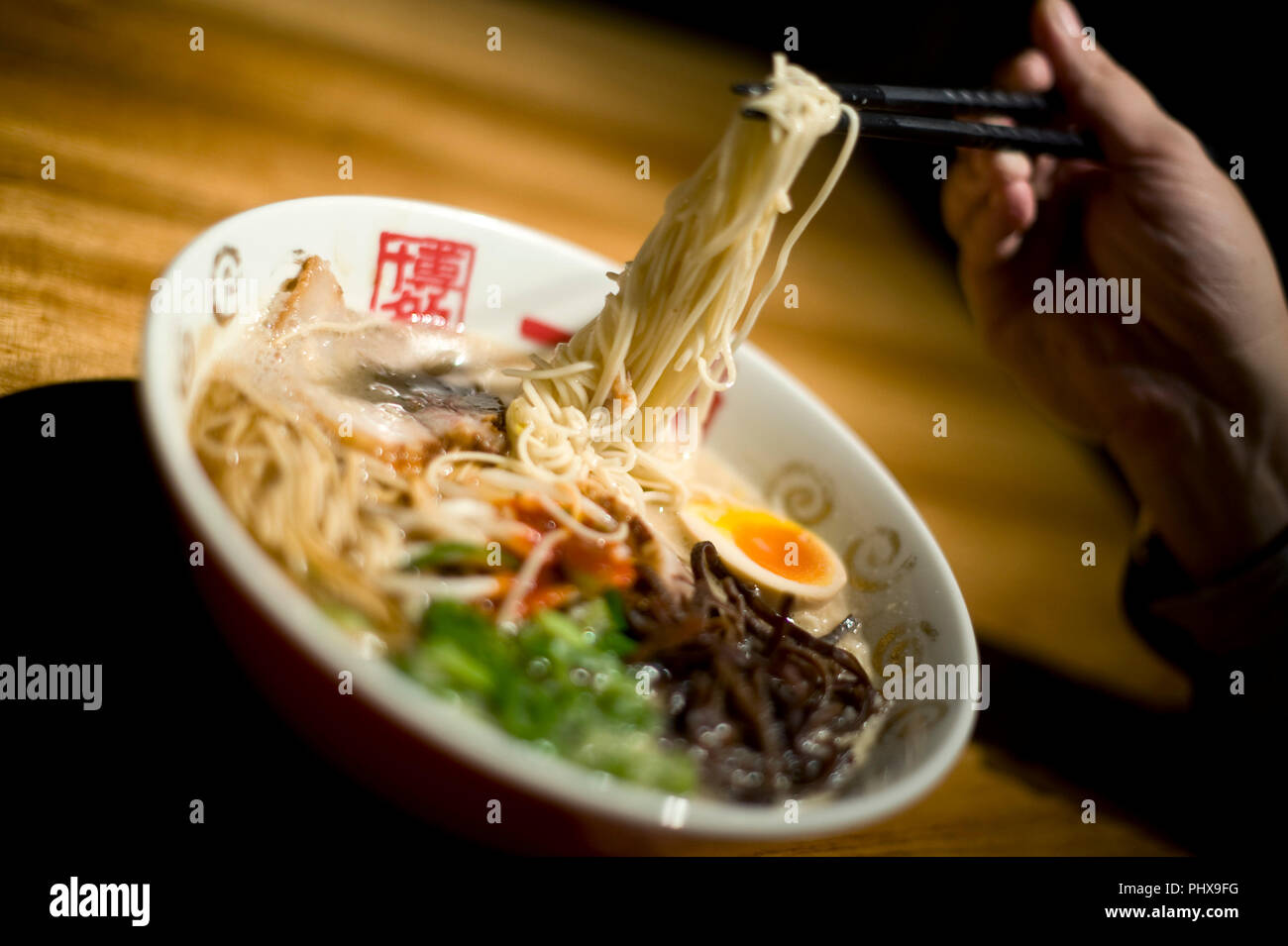 Photo shows soup noodles prepared at Hakata Ippudo Ramen's main store in the Daimyo district of Fukuoka City, Fukuoka Prefecture Japan on 08 March 201 Stock Photo