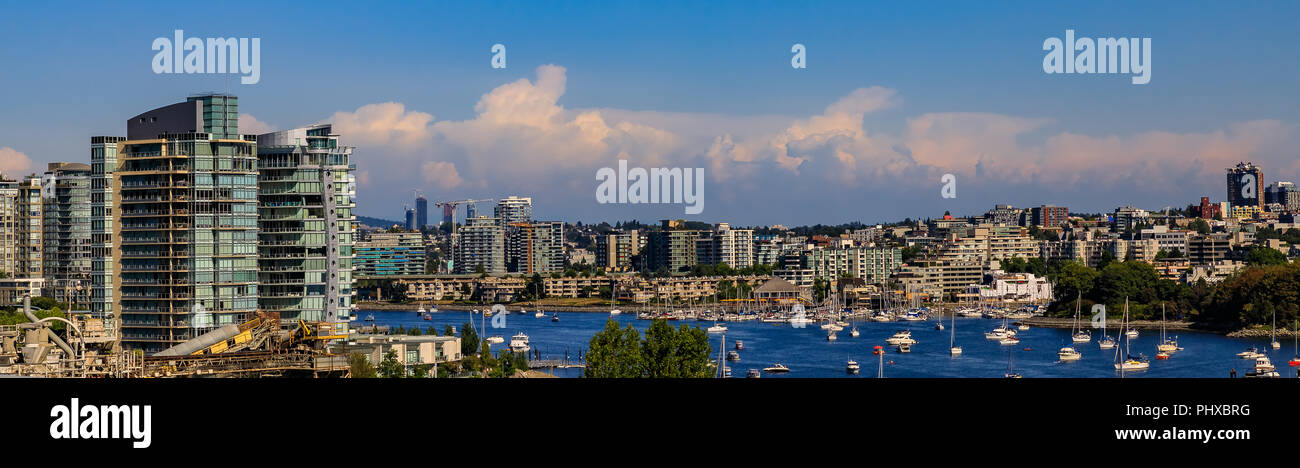 City skyline and waterfront with boats on False Creek from Granville Bridge in Vancouver, Canada. Stock Photo