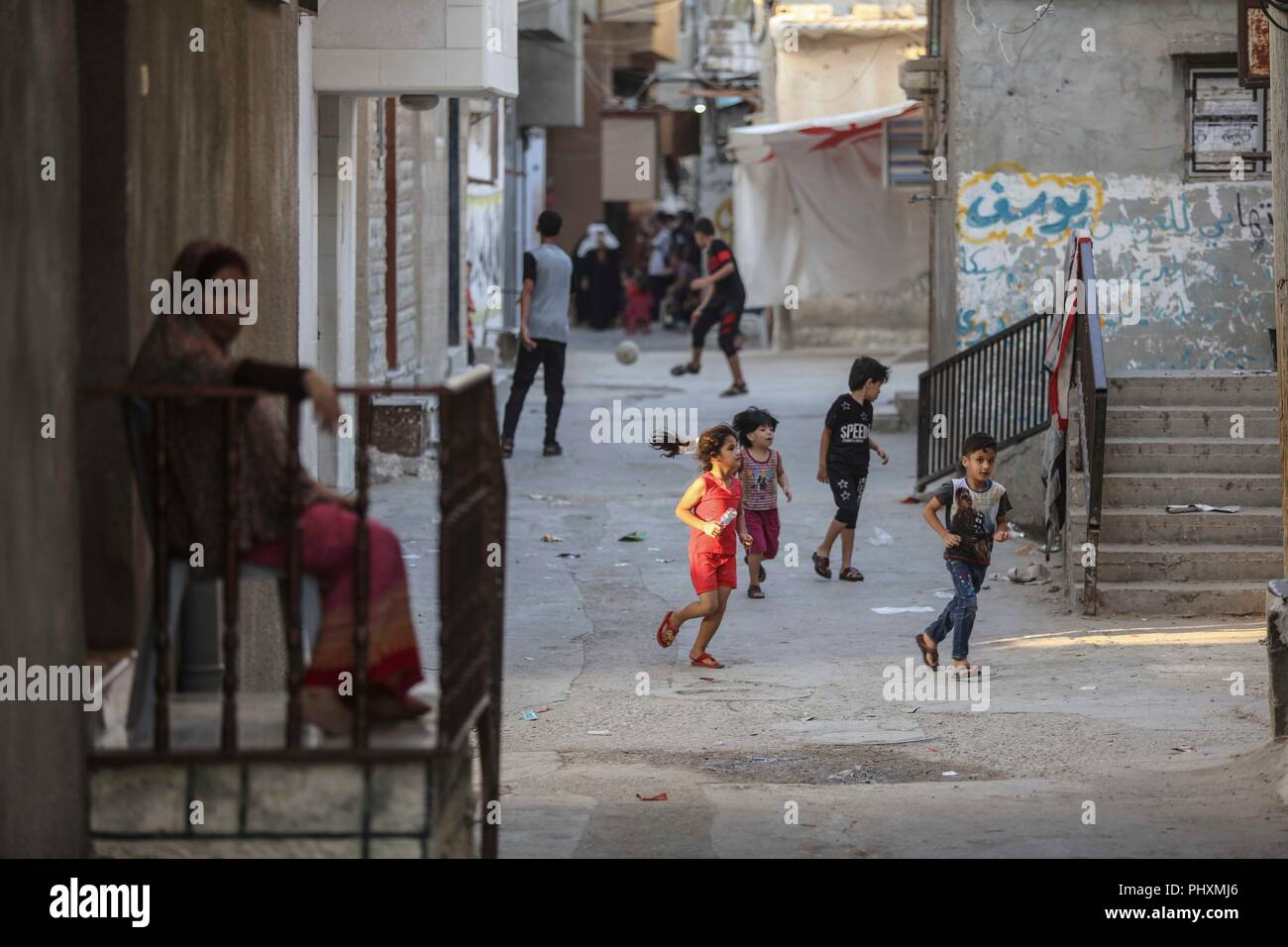 Gaza. 2nd Sep, 2018. Palestinian children play outside their home in the Shati refugee camp in Gaza City, on Sept. 2, 2018. Palestinian President Mahmoud Abbas said Sunday that the question of the Palestinian refugees has to be resolved in accordance with the legitimate international resolutions. Credit: Wissam Nassar/Xinhua/Alamy Live News - Stock Image