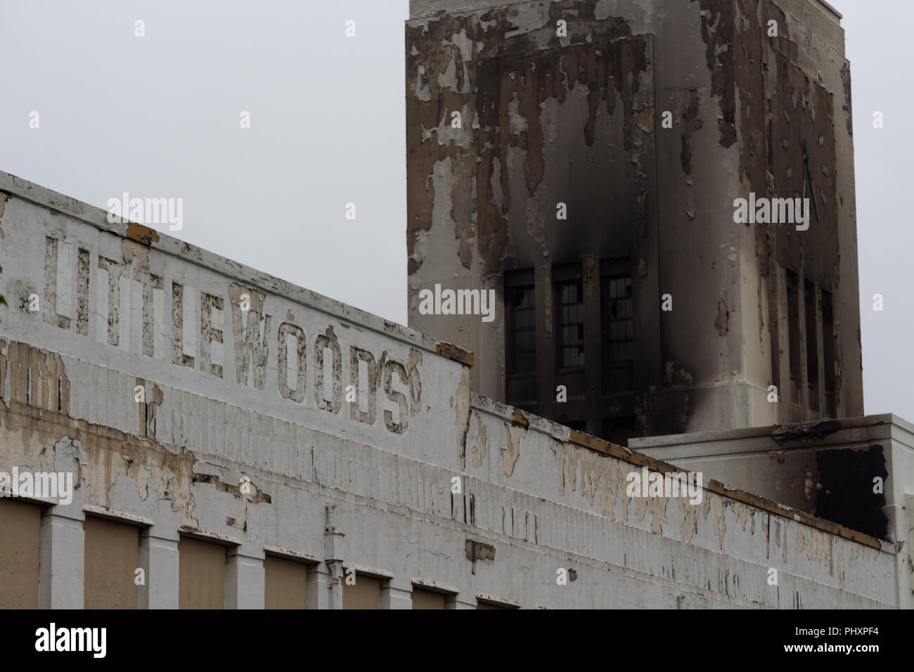 Liverpool UK. 3rd September, 2018. Firefighters continue to damp down the historic Littlewoods building on Edge Lane Liverpool after it was badly damaged by fire on Sunday evening. Credit: Ken Biggs/Alamy Live News. - Stock Image