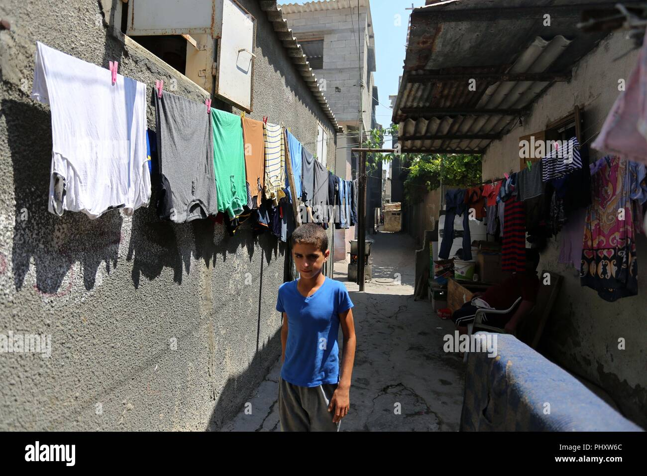 Gaza City, Gaza Strip, Palestinian Territory. 3rd Sep, 2018. A Palestinian refugee boy walks in a street at Al-Shati refugee camp, in Gaza City on September 3, 2018. The United States halted all funding to United Nations' agency that helps Palestinian refugees. State Department spokeswoman Heather Nauert said the business model and fiscal practices of the United Nations Relief and Works Agency (UNRWA) made it an 'irredeemably flawed operation Credit: Ashraf Amra/APA Images/ZUMA Wire/Alamy Live News - Stock Image