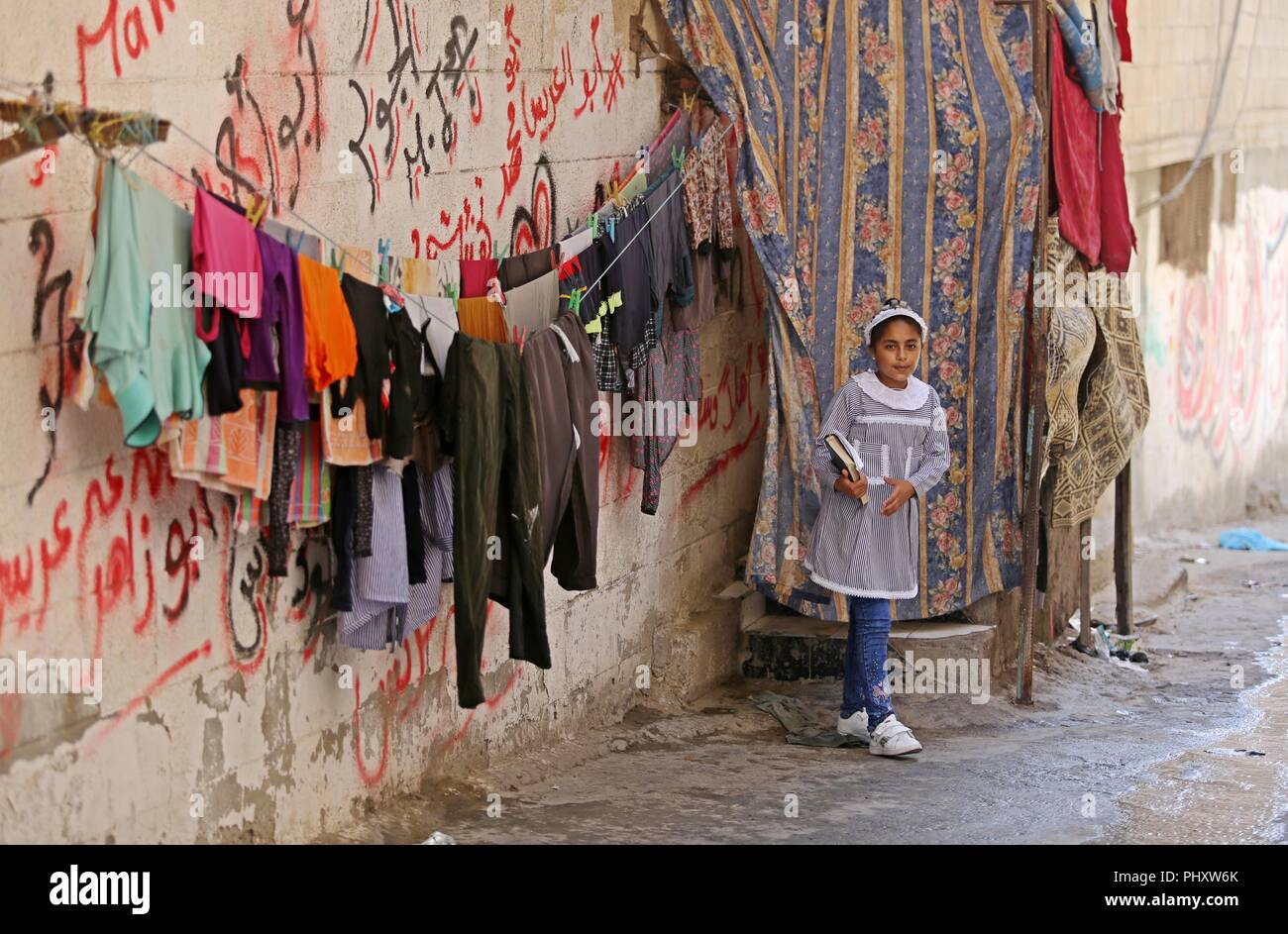 Gaza City, Gaza Strip, Palestinian Territory. 3rd Sep, 2018. A Palestinian refugee girl stands in a street at Al-Shati refugee camp, in Gaza City on September 3, 2018. The United States halted all funding to United Nations' agency that helps Palestinian refugees. State Department spokeswoman Heather Nauert said the business model and fiscal practices of the United Nations Relief and Works Agency (UNRWA) made it an 'irredeemably flawed operation Credit: Ashraf Amra/APA Images/ZUMA Wire/Alamy Live News - Stock Image