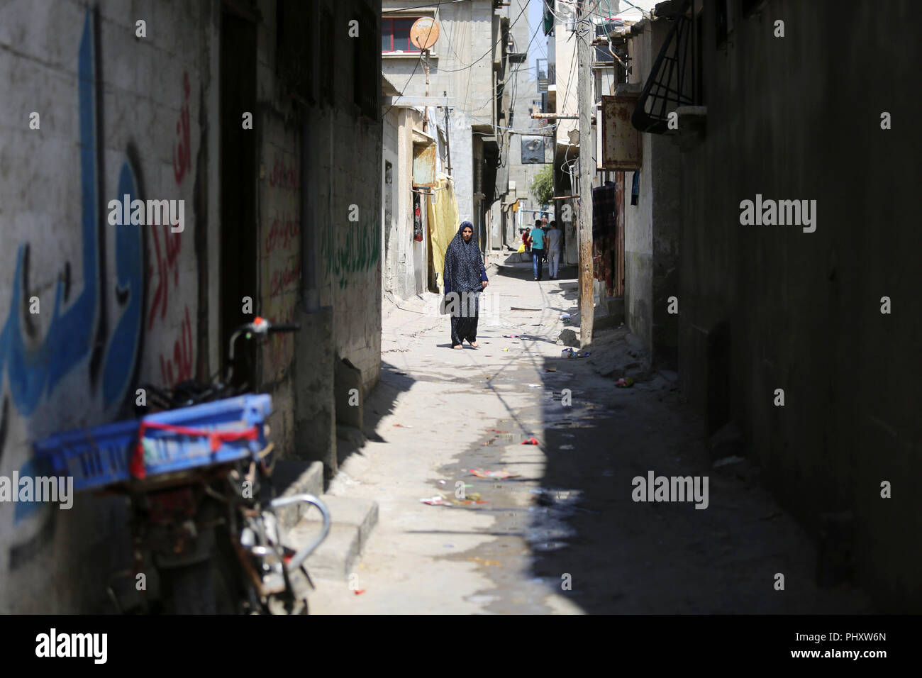 Gaza City, Gaza Strip, Palestinian Territory. 3rd Sep, 2018. A Palestinian refugee woman walks in a street at Al-Shati refugee camp, in Gaza City on September 3, 2018. The United States halted all funding to United Nations' agency that helps Palestinian refugees. State Department spokeswoman Heather Nauert said the business model and fiscal practices of the United Nations Relief and Works Agency (UNRWA) made it an 'irredeemably flawed operation Credit: Ashraf Amra/APA Images/ZUMA Wire/Alamy Live News - Stock Image