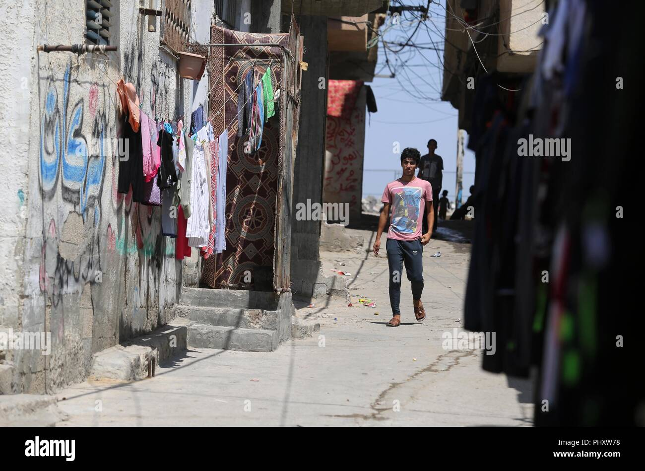 Gaza City, Gaza Strip, Palestinian Territory. 3rd Sep, 2018. Palestinian refugees walk in a street at Al-Shati refugee camp, in Gaza City on September 3, 2018. The United States halted all funding to United Nations' agency that helps Palestinian refugees. State Department spokeswoman Heather Nauert said the business model and fiscal practices of the United Nations Relief and Works Agency (UNRWA) made it an 'irredeemably flawed operation Credit: Ashraf Amra/APA Images/ZUMA Wire/Alamy Live News - Stock Image