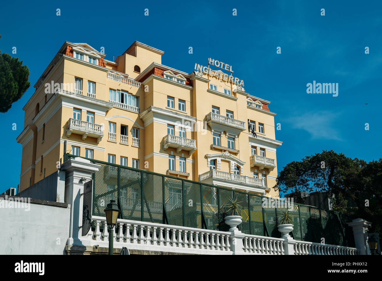Estoril, Portugal - August 30th, 2018: Facade of Belle Epoque style Hotel Inglaterra in Estoril, famous for hosting WWII-era spies - Stock Image