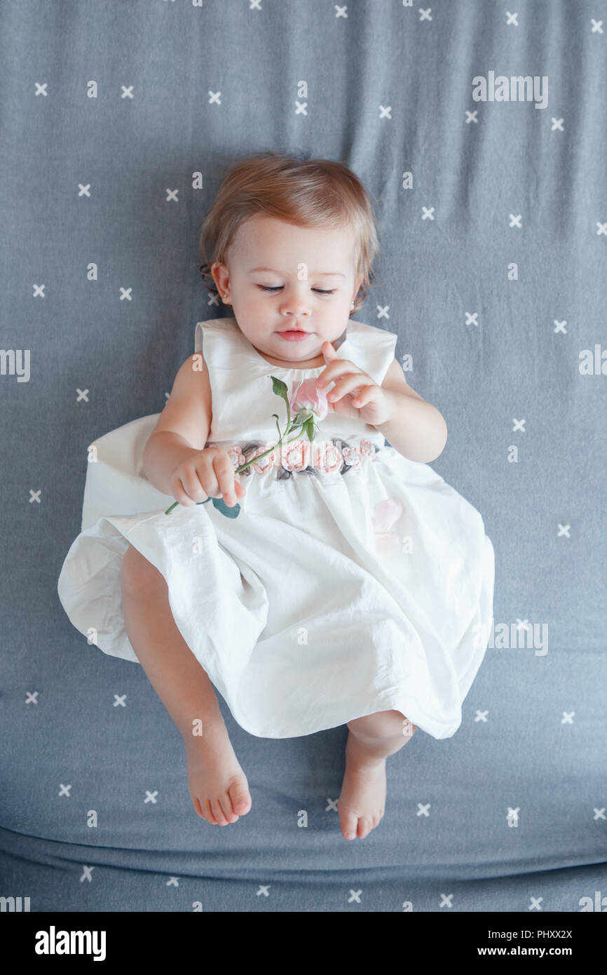 63b9039dd Portrait of cute adorable smiling Caucasian blonde baby girl one ...