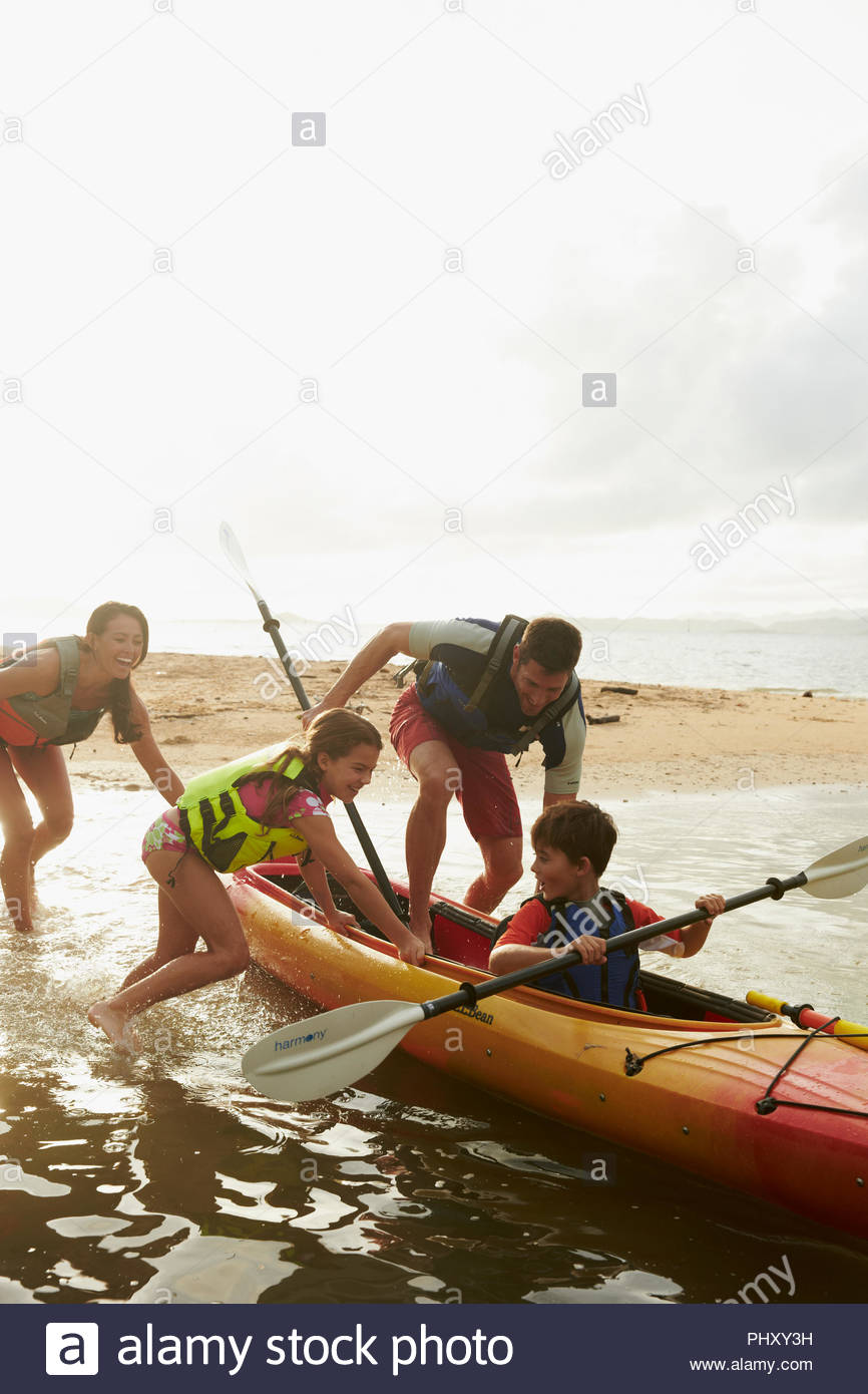 Woman kayaking on sea - Stock Image