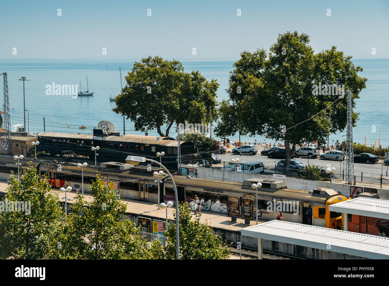 Cascais, Portugal - August 30, 2018: High perspective view of commuters at Cascais railway station, 30km west of Lisbon, Portugal Stock Photo