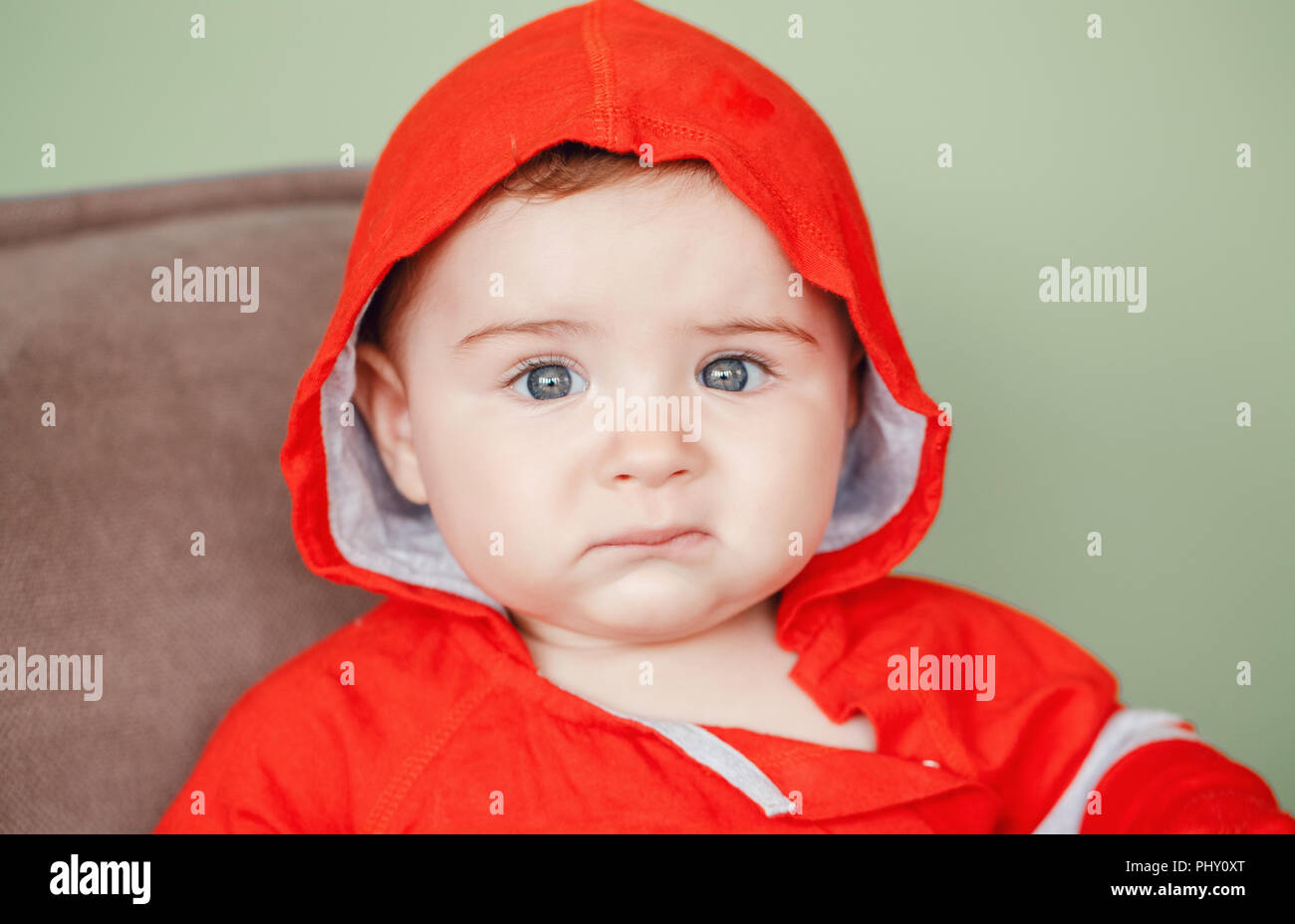 3705ab43a15 Closeup portrait of cute adorable Caucasian upset sad baby boy with blue  eyes