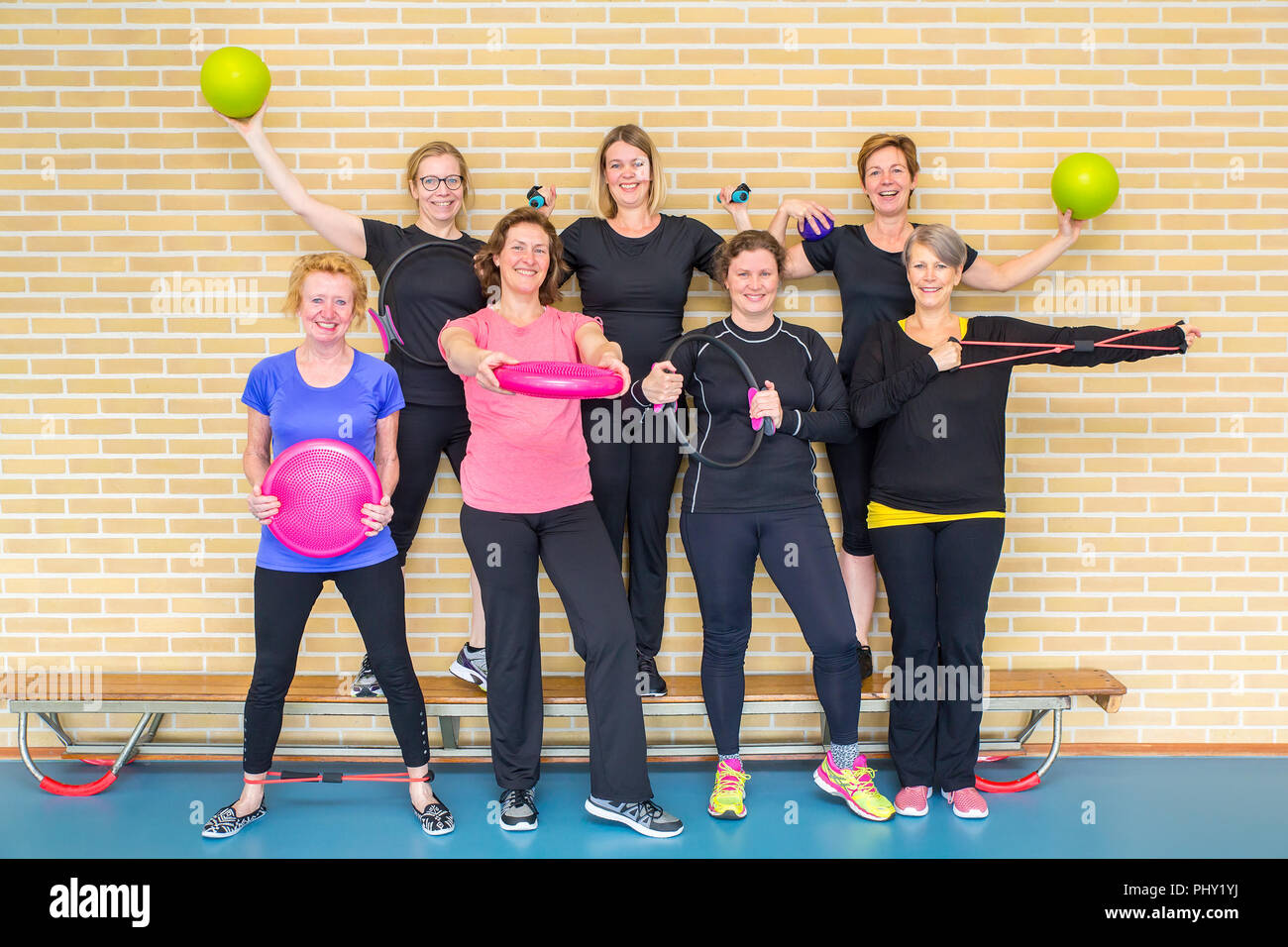 Group photo dutch women gym class with sport equipment Stock Photo