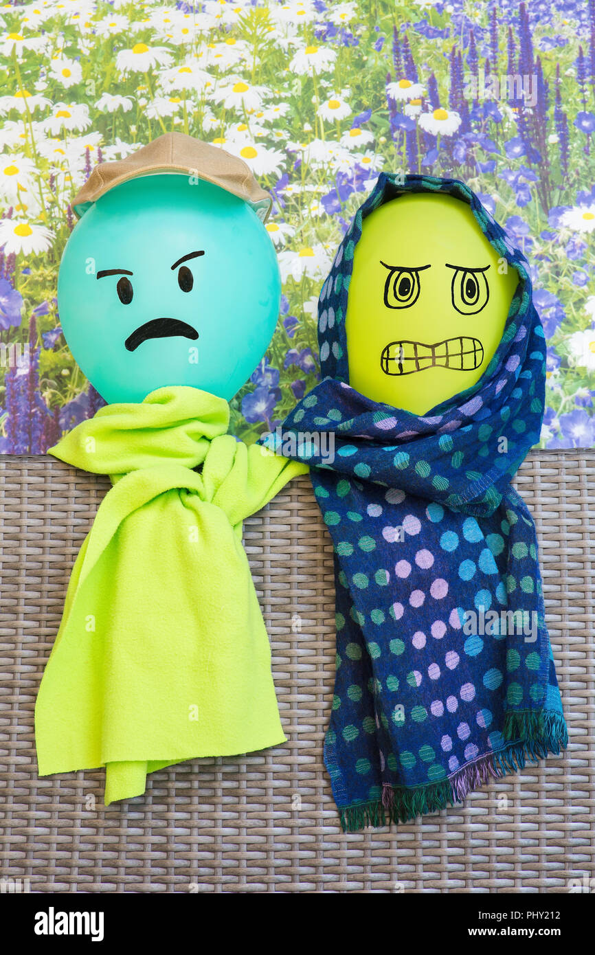 Two balloons with angry faces and shawls Stock Photo