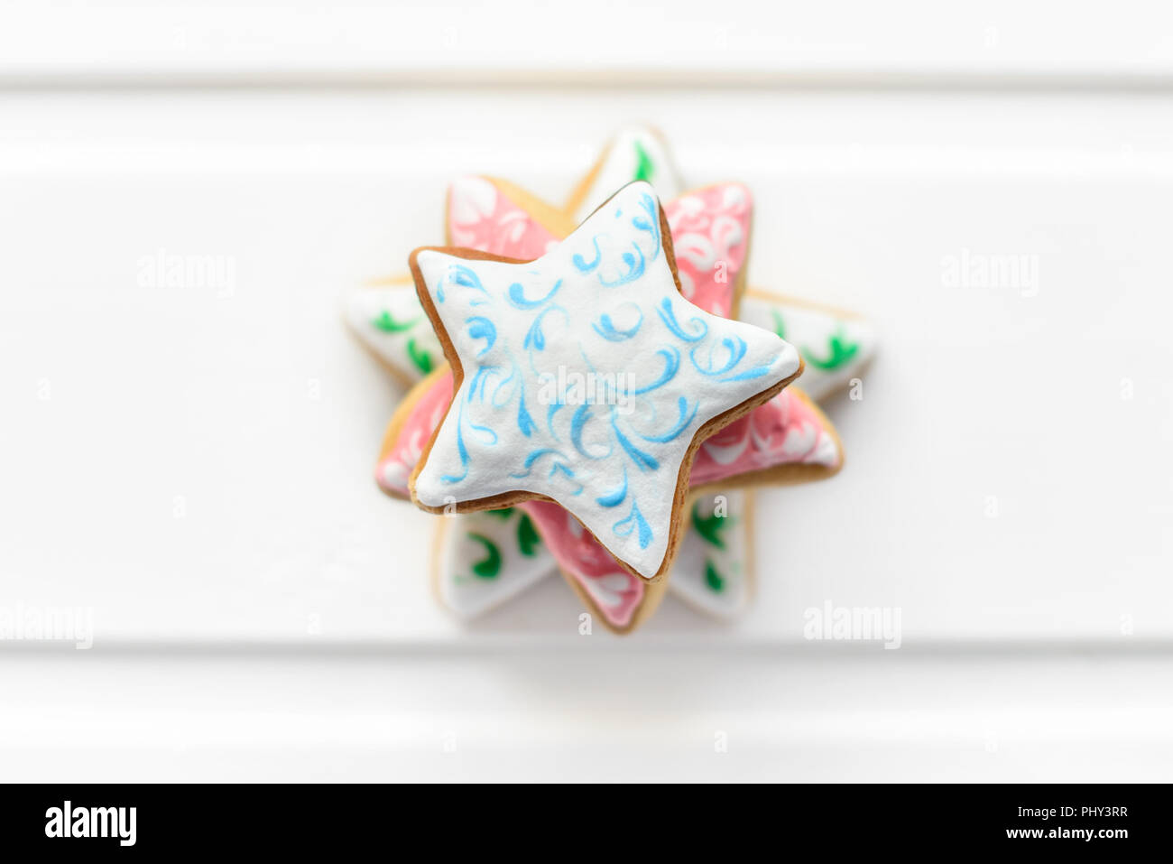 Christmas cookies with festive decoration and on white wooden ...