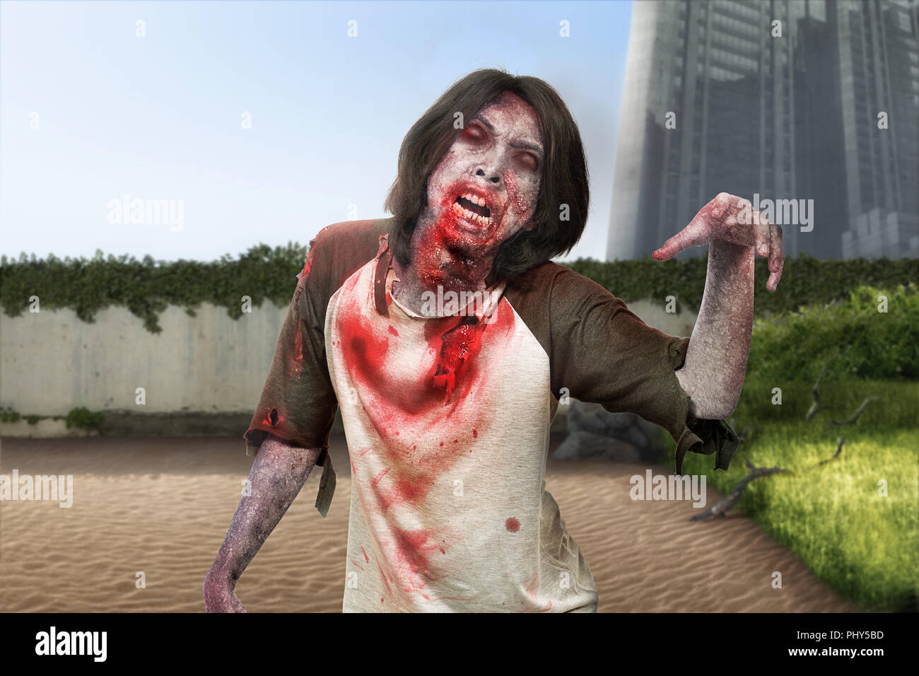 Spooky zombie man with ripped clothes walk around on abandoned city. Halloween concept Stock Photo
