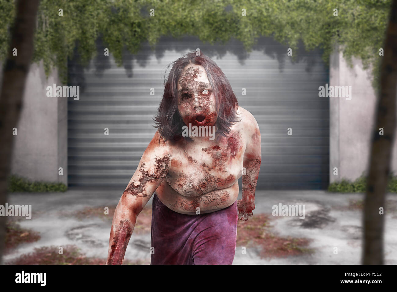 Terrible zombie man with bloody mouth hang around on abandoned city Stock Photo