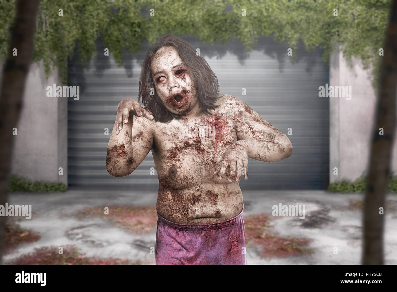 Terrible zombie man with wound on his body haunting abandoned city Stock Photo