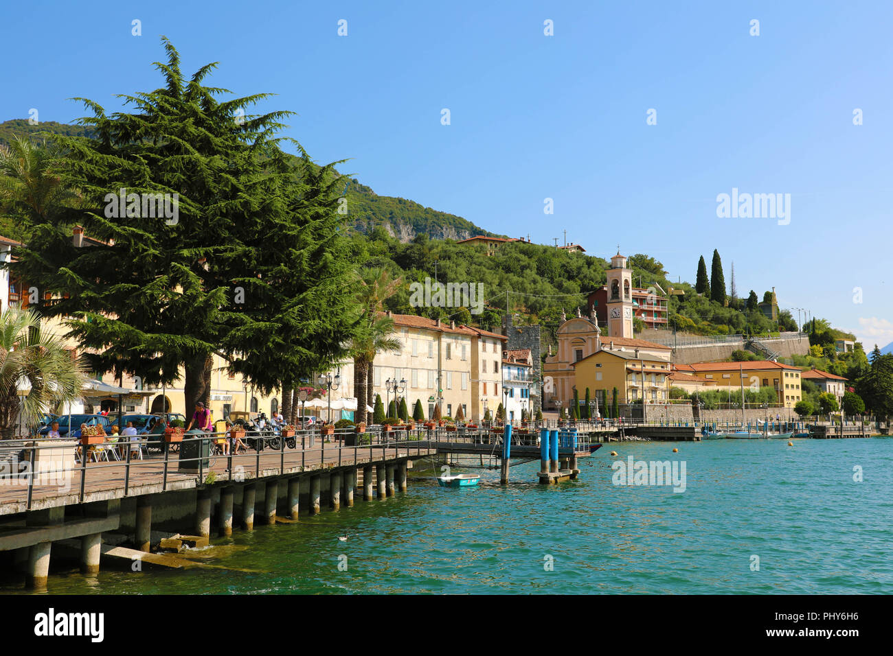 LAKE ISEO, ITALY - AUGUST 20, 2018: view of small village with church on Lake Iseo, Italy - Stock Image
