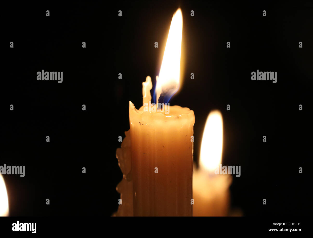 All saints day candles stock photos all saints day candles stock close up of burning wax candles in the dark candle flame candlewick christmas m4hsunfo