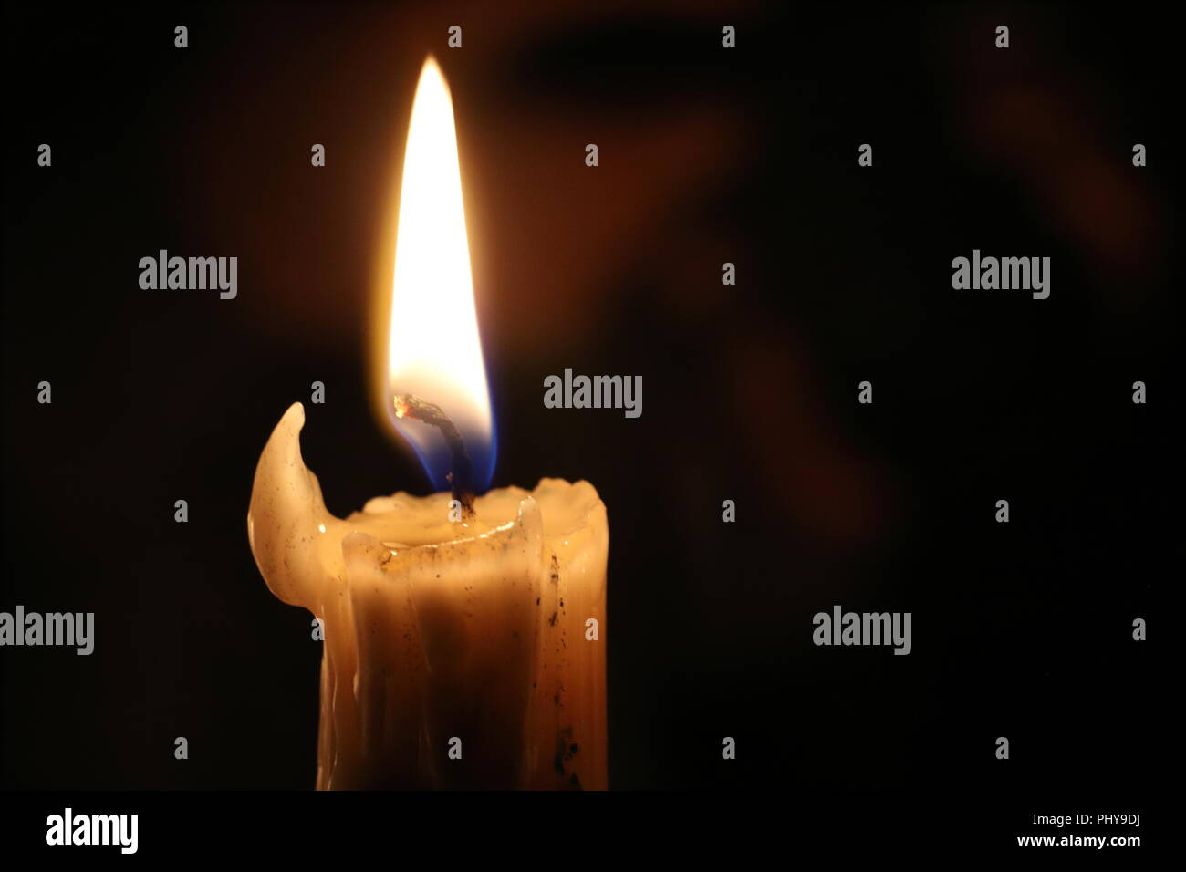Symbol all saints day stock photos symbol all saints day stock close up of burning wax candle in the dark candle flame candlewick christmas m4hsunfo