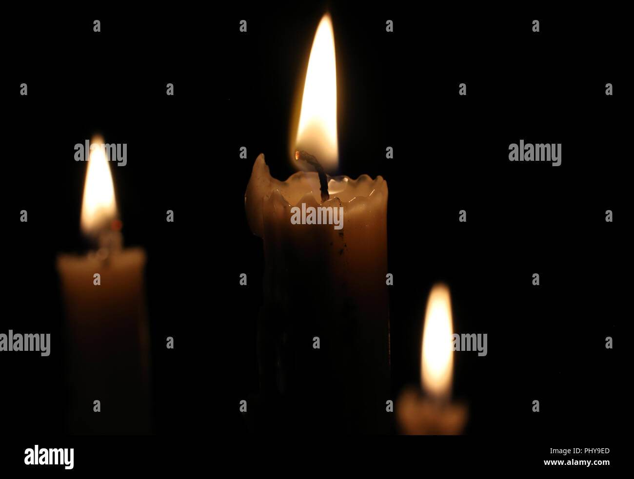 All saints day candles stock photos all saints day candles stock burning candles at all saints day m43tch rm burning candles in the dark candle flame christmas new year greeting card m4hsunfo