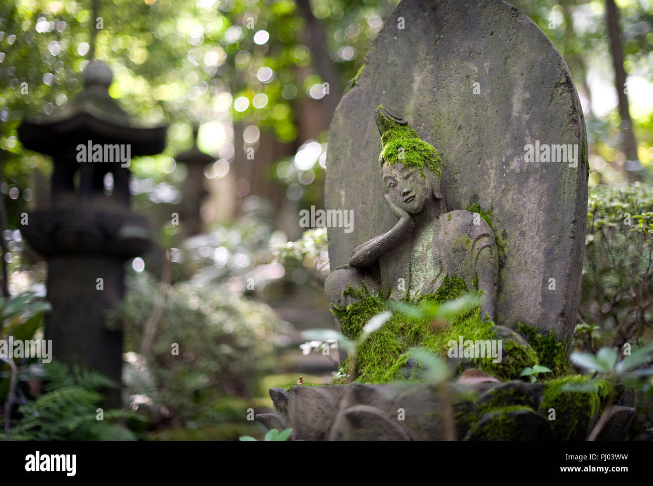 Photo shows a stone Buddha statue on display in the gardens of the Nezu Museum of Art in, Tokyo, Japan on 17 Sept. 2012. The  museum was  first concep Stock Photo