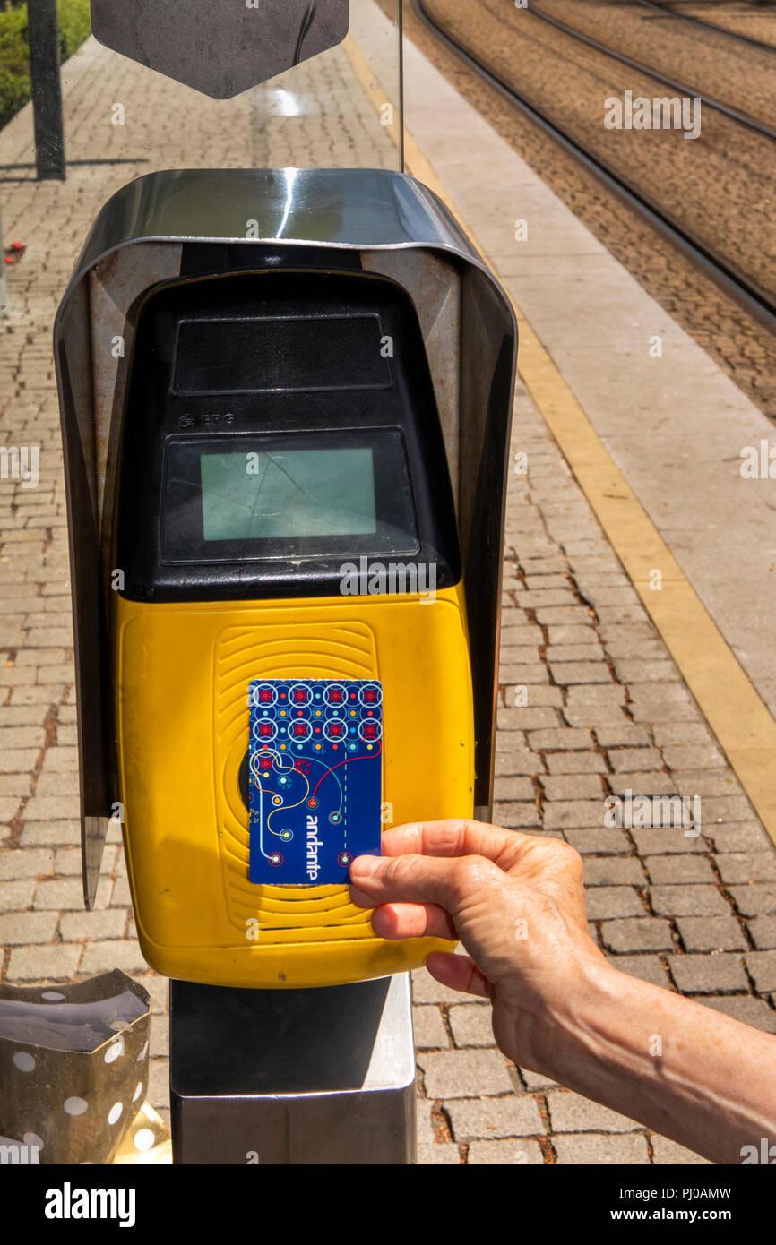 Portugal, Porto, Matosinhos, public transport, validating Metro Station ticket  at suburban station - Stock Image