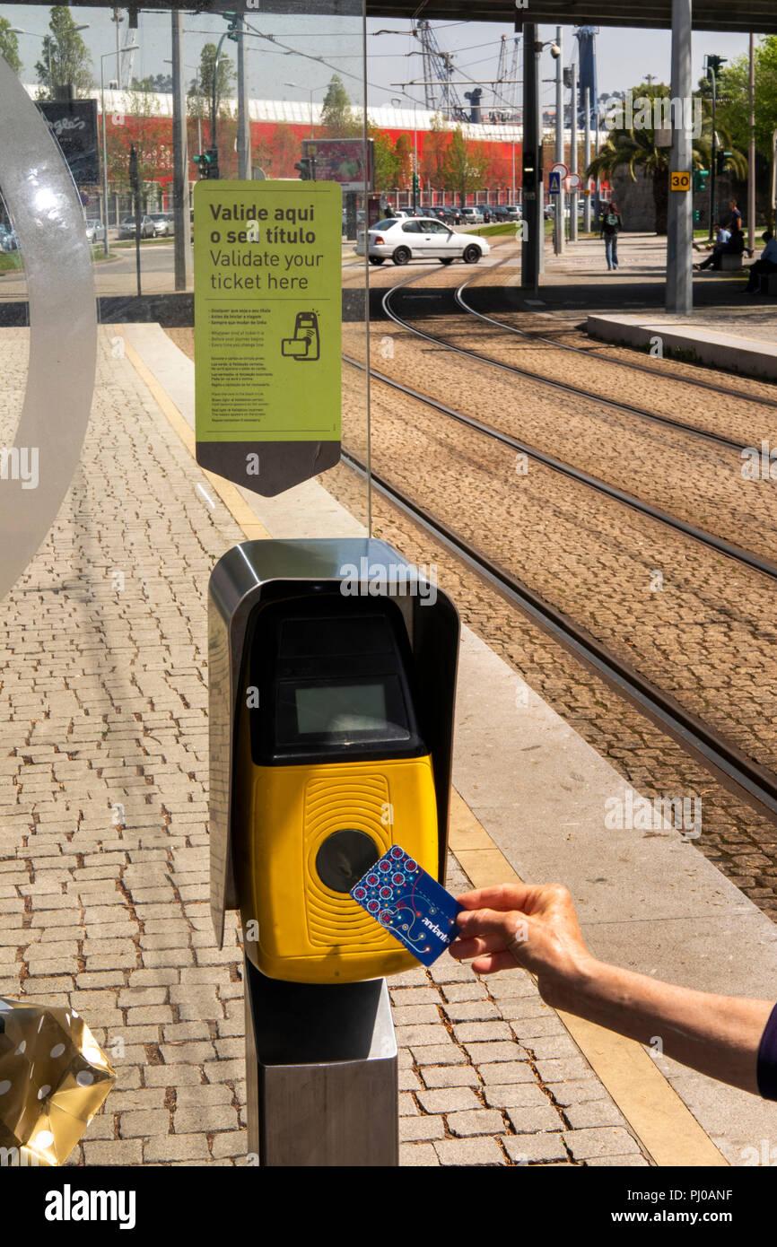 Portugal, Porto, Matosinhos, public transport, validating Metro Station ticket  at suburban station before journey - Stock Image