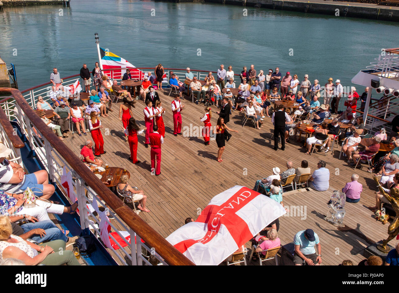 Portugal, Porto, Matosinhos, Leixoes, MV Marco Polo passengers being entertained on deck in sunshine - Stock Image