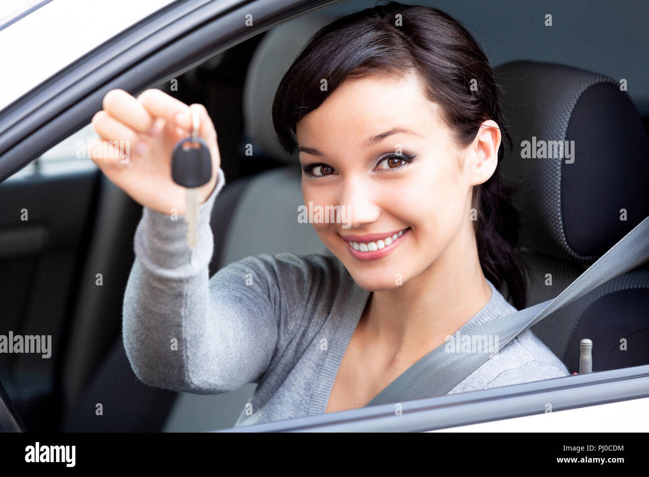 Happy Owner Of A New Car Is Showing The Key Pretty Girl Driver