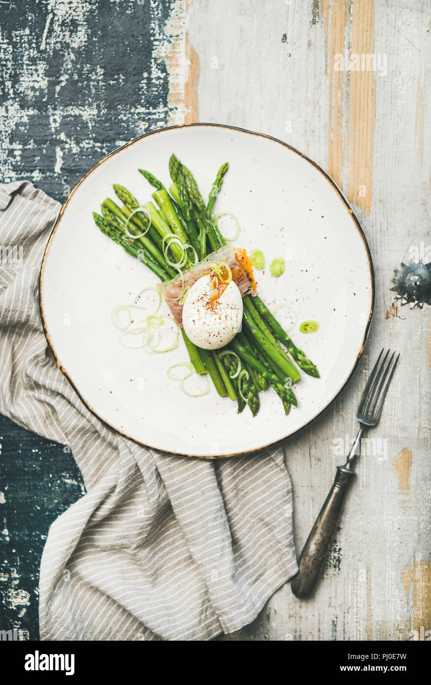 Healthy breakfast with green asparagus, soft-boiled egg , bacon - Stock Image