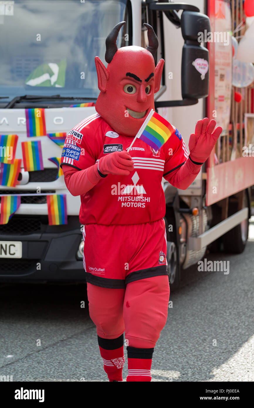 Salford Red Devils taking part in the 2018 Manchester Pride Parade. - Stock Image