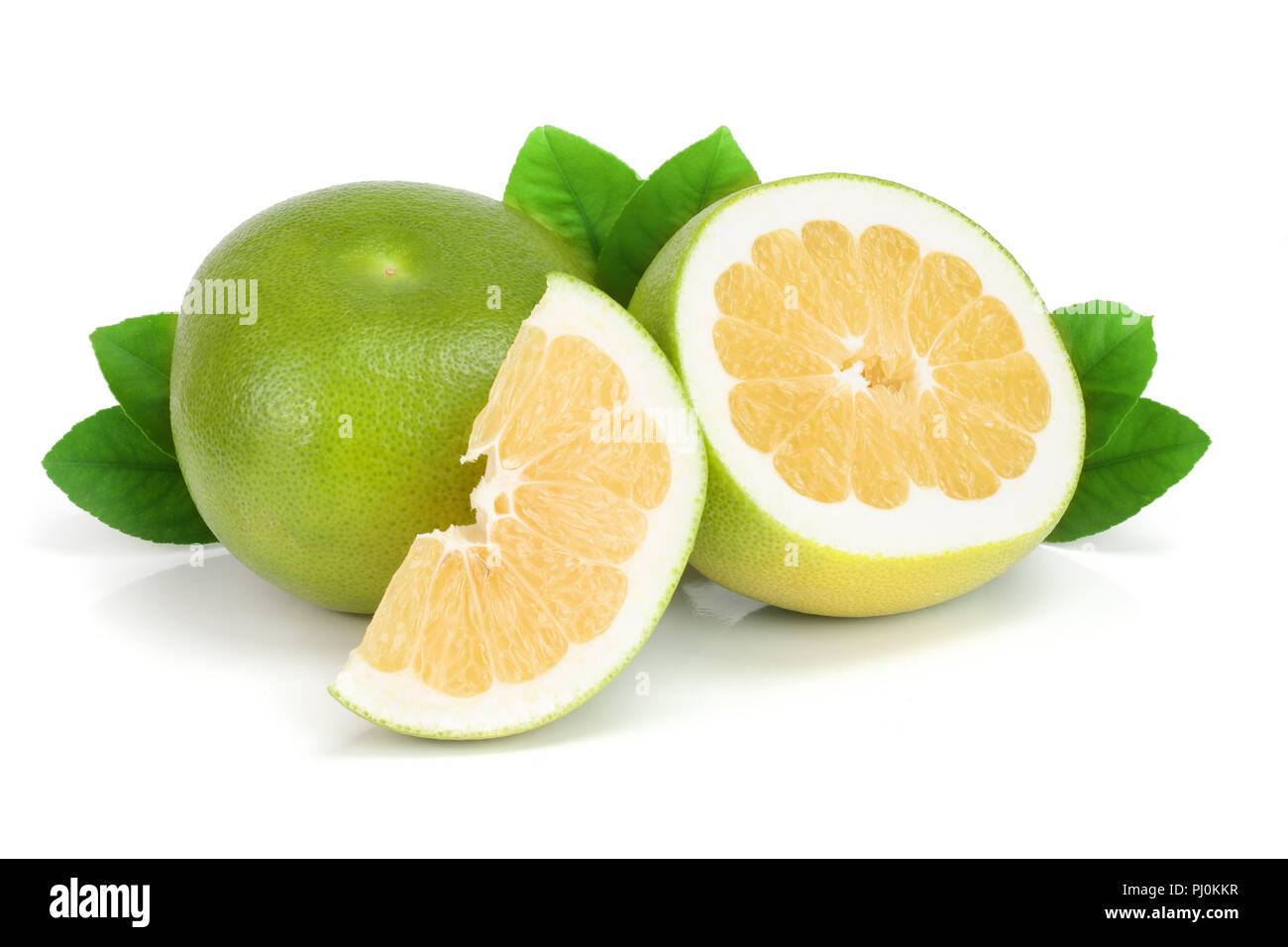 Citrus Sweetie or Pomelit, oroblanco with slices and leaf isolated on white background close-up. - Stock Image