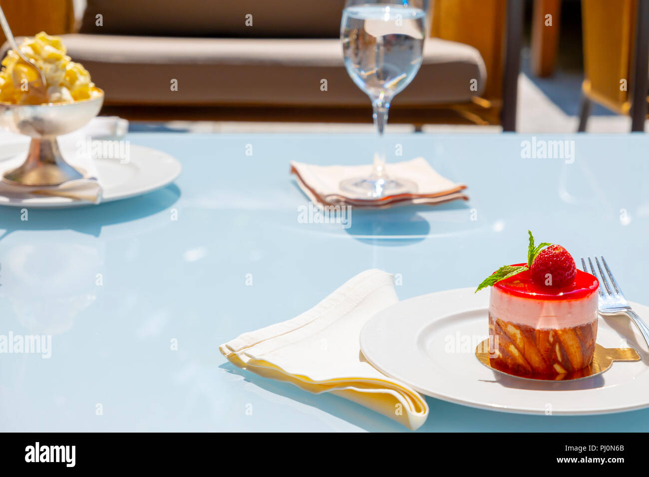 Strawberry Cake and Glass of Water. - Stock Image