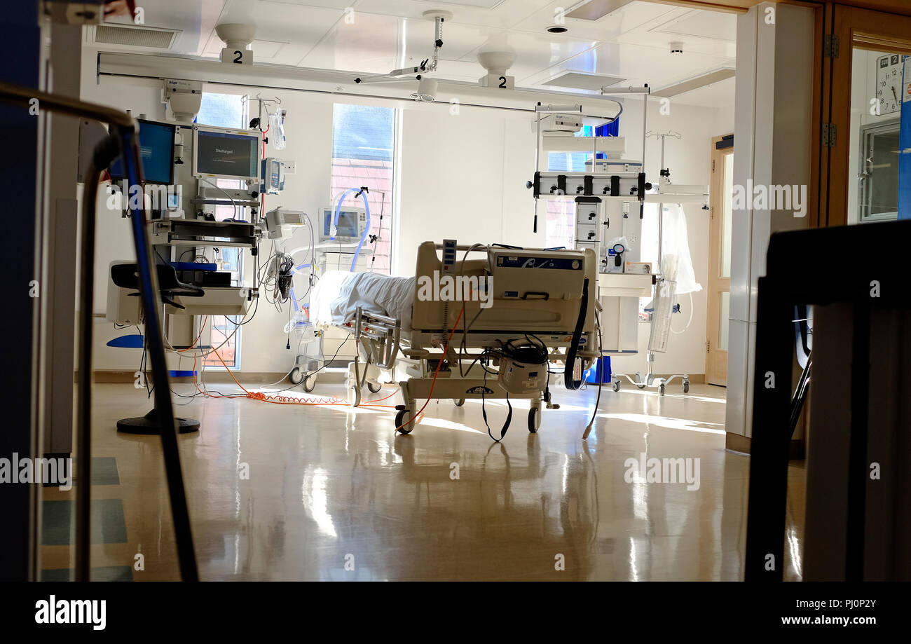 empty hospital bed in intensive critical care unit - Stock Image