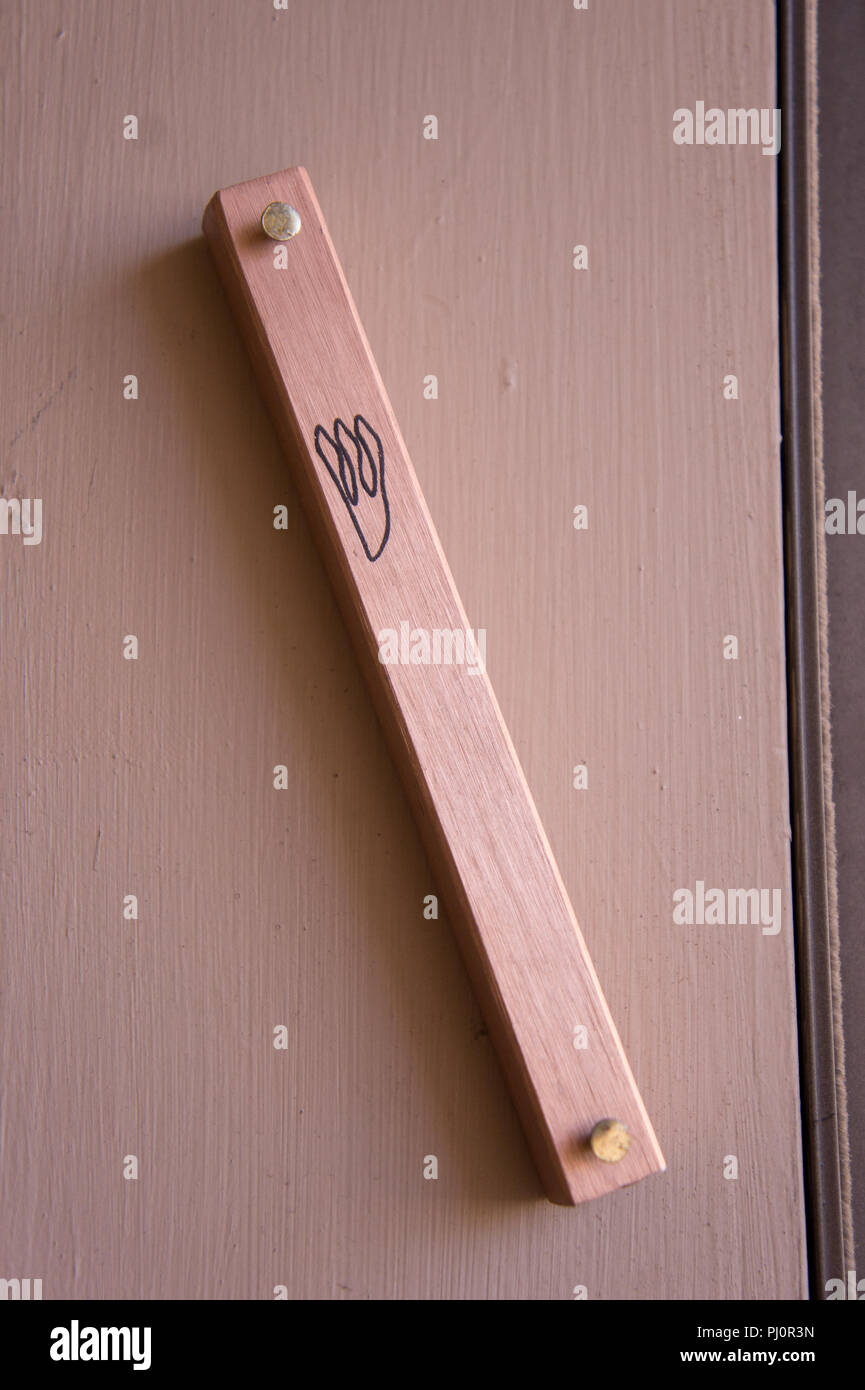 Close up of a mezuza on a doorpost Stock Photo