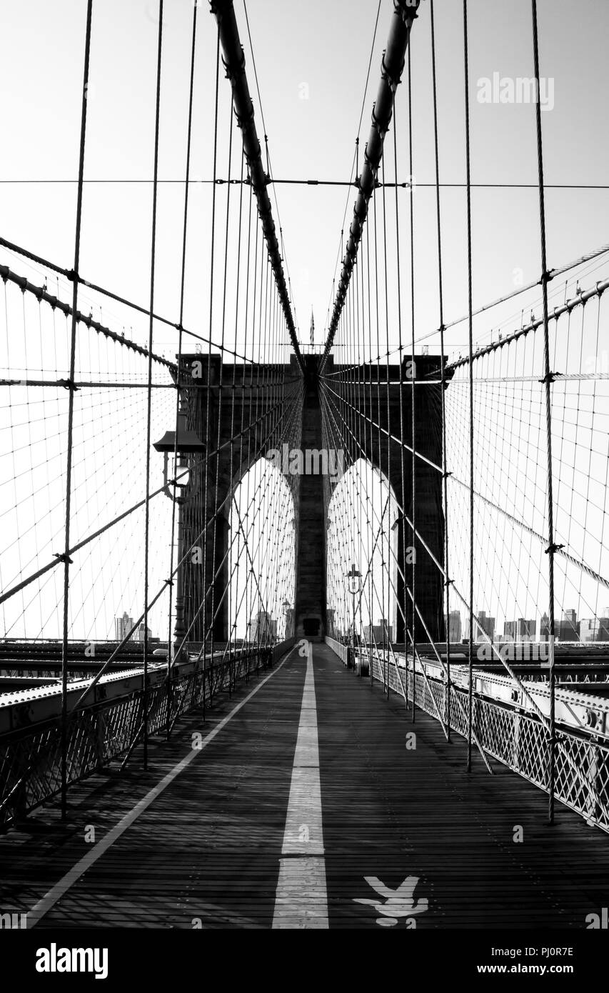 Black and white Brooklyn Bridge walkway morning boardwalk, New York City. - Stock Image