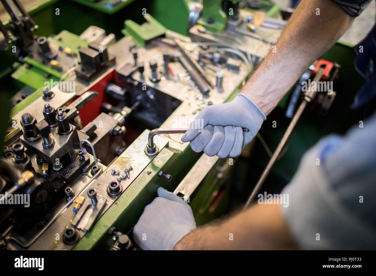 Working on machine - Stock Image