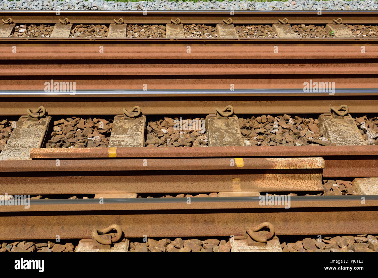 Spare long-welded rails stored between the running lines