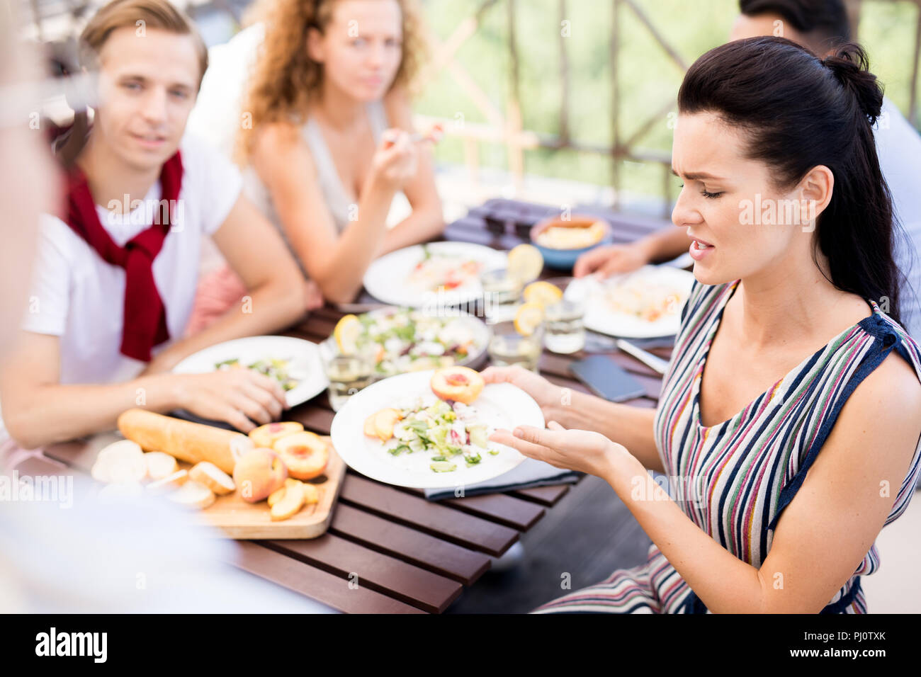 Guests Complaining in Cafe - Stock Image